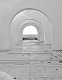 Mystical corridor. Mystical tunnel to the beach - black and white stock photo