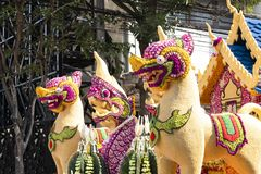 Mystical creatures on a floral float. Details of mystical creatures decorated with fresh flowers on a float used in the February Flower Festival Parades in the royalty free stock image