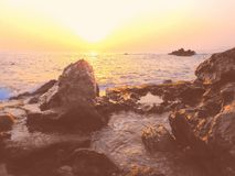 Mystical, cryptic, astonishing sea sunset beach, stony coast stock photos
