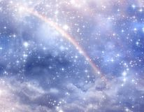 Mystical divine angelic background with rainbow. Beautiful mystical divine gelic magic purple blue background with stars and rainbow royalty free stock image