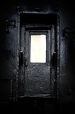The mystical door. The old black door. Log into the unknown royalty free stock photo