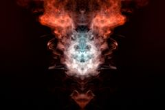 A mystical figure depicting the head of a fox and bringing in flames from multicolored billowing smoke: orange, yellow and white, royalty free stock image