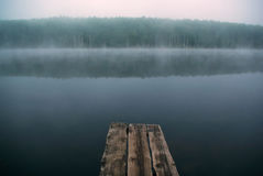The mystical fog on the lake. Mystical mysterious fog on the lake early in the morning Royalty Free Stock Photography