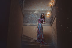 Mystical girl. Mystical girl standing on the stairs and conjures Stock Photography