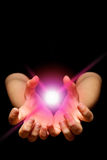 Mystical glow. Female hands holding a mystical glowing ball stock images