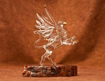 Mystical Griffin. Crystal Griffin on Wood Slab for miscellaneous use and/or interior decorative purposes Royalty Free Stock Image
