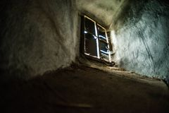 Mystical interior. Window in dark castle dungeon. Mystical interior. Old window in dark castle dungeon. Ray of light stock photography