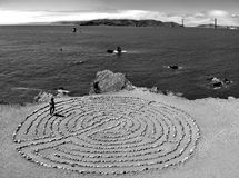 Mystical Labyrinth at lands end in San Francisco with view at the famous golden gate bridge, California, USA. Watching a girl walking in the famous stone stock photo
