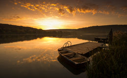 Mystical Landscape, Boat on the Pier at sunrise Royalty Free Stock Photography