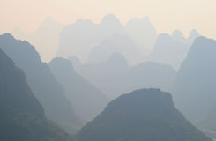 Mystical landscape of misty karst peaks, Yangshuo, China Royalty Free Stock Photos