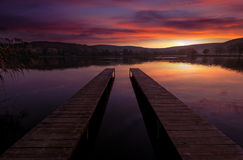 Mystical Landscape, two long pier at dawn Royalty Free Stock Photo