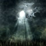 Mystical moonlight flowing from the dark sky Royalty Free Stock Photo