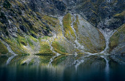 Mystical mountain lake. Dramatic view of Black Lake below Mount Rysy, Eastern Tatras, Poland royalty free stock photos
