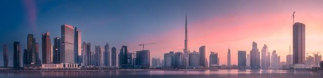 Panoramic view of Dubai Business bay, UAE. Mystical panoramic view of Dubai Business bay with purple sunrise, UAE Royalty Free Stock Photography