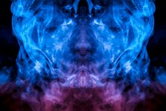 The mystical pattern of a person`s face from evaporating smoke in thin tongues is like a flame of blue on a black background. The mystical pattern of a person`s royalty free illustration