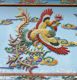 Mystical Phoenix. An exotic colorful mythical phoenix bird which symbolise rebirth, immortality and renewal on a temple wall royalty free stock photos