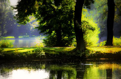 Mystical ponds. Small lakes in magical mist. Sunny, hazy, dark forest. Causeway between two ponds. Dutzendteich in Nuremberg, Germany Stock Photos