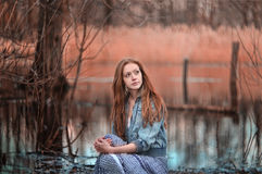 Mystical portrait of redheaded girl in the swamp Stock Images