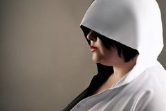 Mystical profile fat woman in hood. Isolated on gray background royalty free stock images