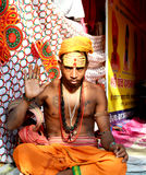 A mystical sadhu with forehead makeup and chest tattoos in great kumbh mela 2016, Ujjain India. A mystical sadhu (holy man) in full body and forehead makeup and royalty free stock photo