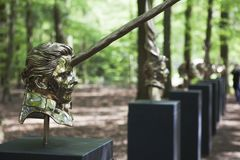Mystical sculptures by Jan Fabre under the name CHAPTERS I - XVIII. Park De Hoge Veluwe. Otterlo. Netherlands. Otterlo, The Netherlands - May 2, 2018: Polished royalty free stock image