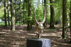 Mystical sculptures by Jan Fabre under the name CHAPTERS I - XVIII. Park De Hoge Veluwe. Otterlo. Netherlands. Otterlo, The Netherlands - May 2, 2018: Polished royalty free stock photos