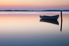 Mystical sea with boat. Abstract natural backgrounds. Royalty Free Stock Photos