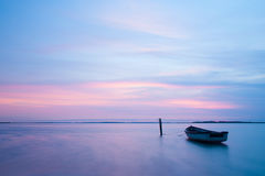 Mystical sea with boat. Abstract natural backgrounds. Stock Image