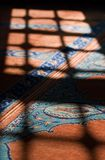 Mystical Shadow. Late afternoon light on the carpet in a mosque, in istanbul, Turkey Royalty Free Stock Photo