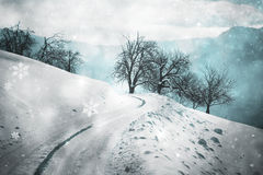 Mystical snowy countryside road with added snowflakes Stock Photography