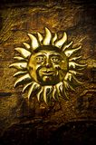Mystical Sun. Gold mystical Sun over brown grunge background royalty free stock photography