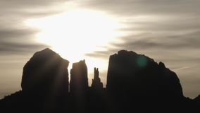 Mystical Sun and Clouds Behind Sedona Rock Formations Slow Pan Time Lapse
