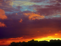 Mystical sunset. Landscape of houses silhouetted against a sunset Royalty Free Stock Photos