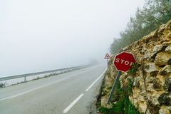 Mystical views of the road in dense fog in the mountains of the Iberian Peninsula royalty free stock photo