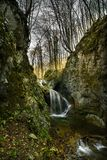 The mystical waterfall and the last sunshine. The mystical waterfall and the last sun rays hidden in the inaccessible forest of the Rhodope Mountains royalty free stock photo