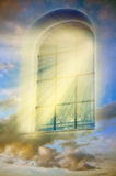 Mystical window. A window with mystical Divine angelic rays of light over beautiful sky like a spiritual ans mystical concept Stock Image