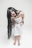 Mystical witch screaming woman looking at you Royalty Free Stock Photography