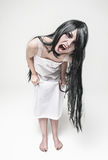 Mystical witch screaming woman looking at you Stock Image