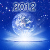 Mystical year 2012. Our planet Earth in rays of light with 2012 vector illustration