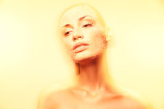 Mystical young woman with creative golden makeup Stock Photo