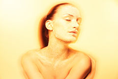 Mystical young woman with creative golden makeup Royalty Free Stock Photo