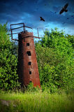 Mysticism rusty water tower. With crows Royalty Free Stock Photography