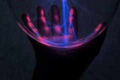 Mystieke hand met plasma royalty-vrije stock afbeeldingen