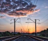 Mystikerjärnväg och solljus Arkivfoto