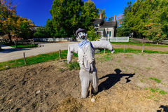 Mystique view of scarecrow and his shadow friend standing in farm garden and get ready for Halloween party Royalty Free Stock Photo