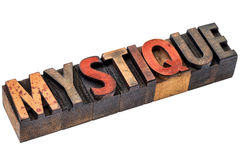 Mystique word abstract in wood type Stock Images