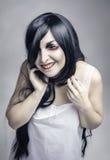 Mystisk tokig skratta spökekvinna Arkivfoto