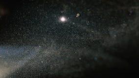 Mystiskt och kosmiskt damm med att skimra ljus kallt arkivfilmer