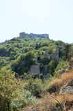 Mystras castle and ruins. Mystras castle at the top of the hill and ruins royalty free stock photo