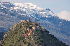 Mystras Castle, and Taygetus mountain. The Byzantine castle of Mystras, and Mountain Taygetos at the background Stock Images
